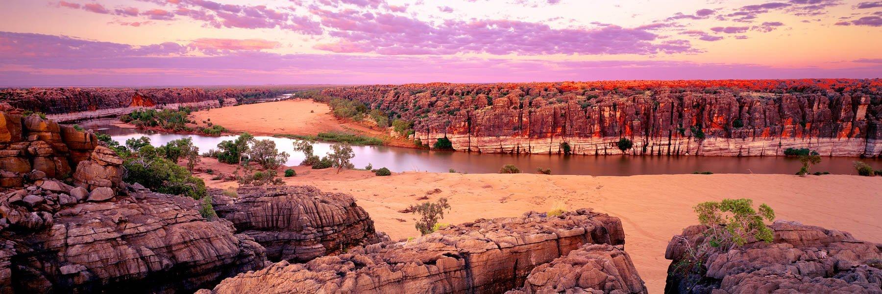 A pastel sunrise over Geikie Gorge, Kimberley, WA, Australia.