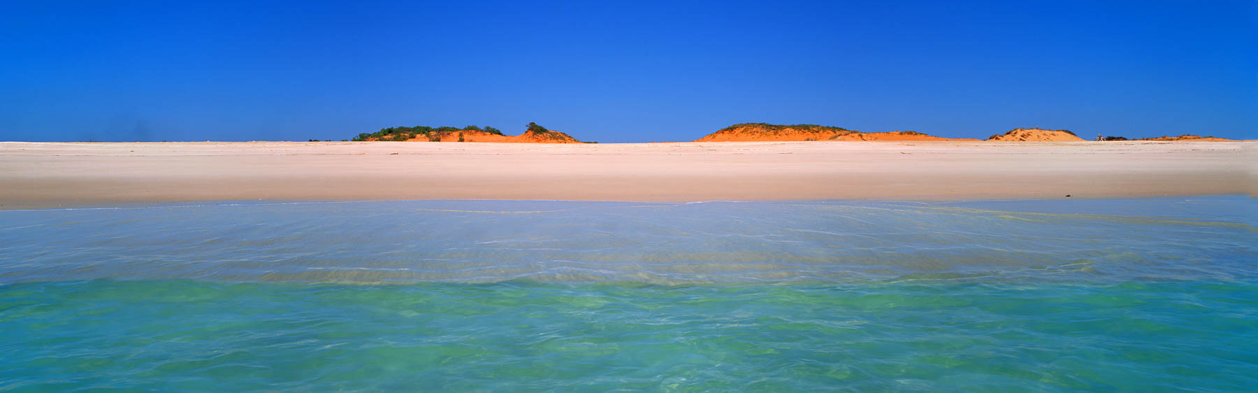 Turquoise water meets the pure white sand of Cape Leveque, WA, Australia.