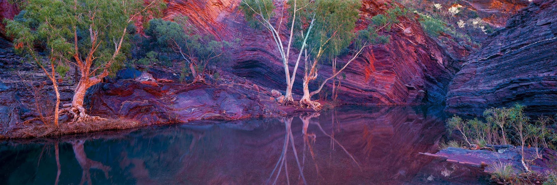Late afternoon reflections in a pool, Hammersly Gorge, WA, Australia.