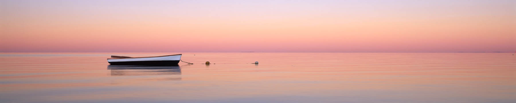 A small dinghy at sunrise in Shark Bay, WA, Australia.