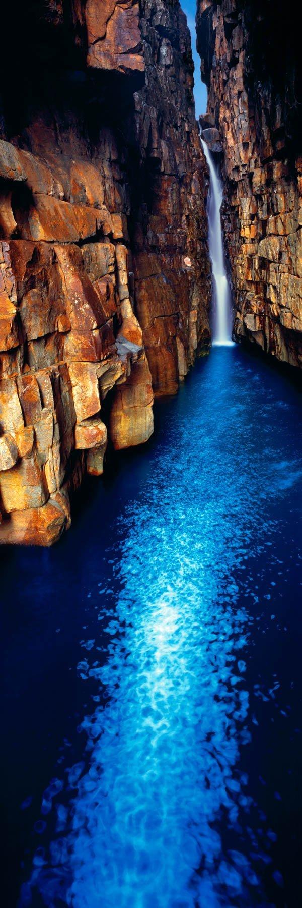 A single waterfall falling down into a Sapphire Pool, Kimberleys, WA, Australia.