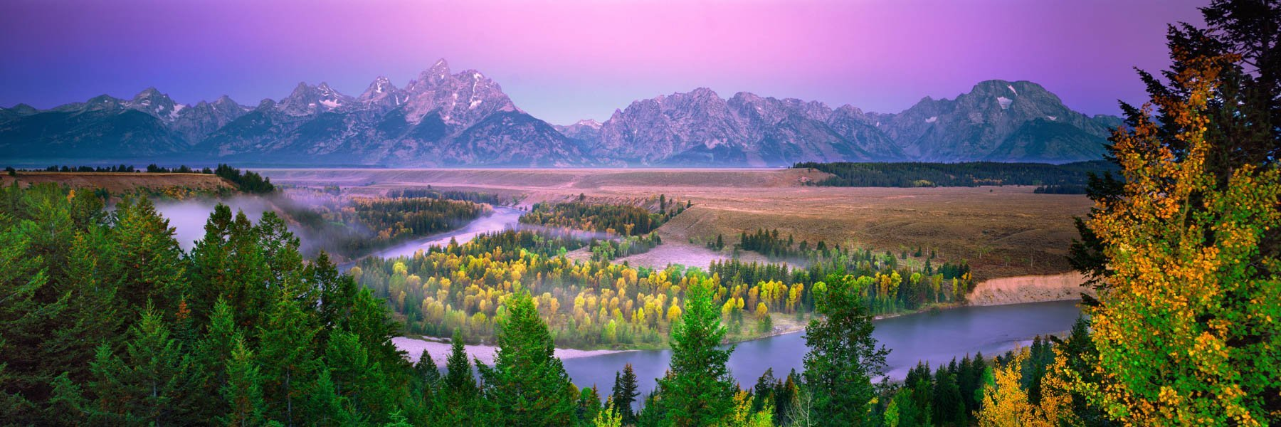 A tranquil, pastel sunrise over Snake River, Grant Teton National Park, Wyoming, USA.