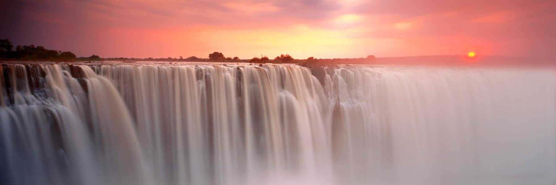 Sun rising through the mist, Victoria Falls, Zimbabwe.