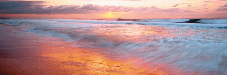 A glorious pastel sunrise over Wamber each, Central Coast, NSW, Australia.
