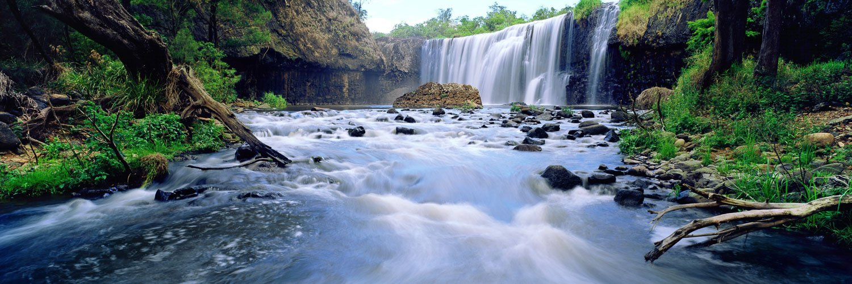 The rushing waters of Millstream Falls after rain, Qld, Australia.