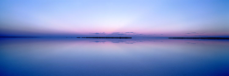 Perfect reflections at twilight in Lake Kambalda, WA, Australia.